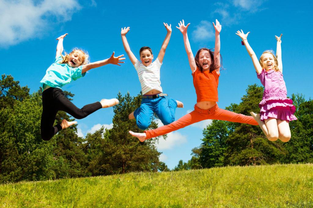 Happy active children jumping